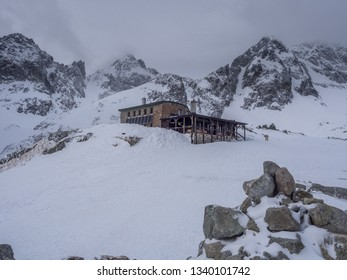 The cloudy day view of Teryho Hut (Téryho Chata) in cold snowy winter time. High Tatras, Slovakia.