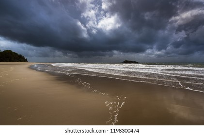 cloudy dramatic stormy tropical Daintree beach Coral sea great barrier reef island