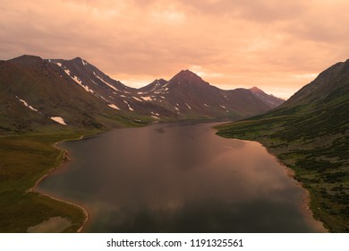 Cloudy evening over the lake Big Hadatayoganlor (aerial photograph). Polar Ural Mountains, Russia