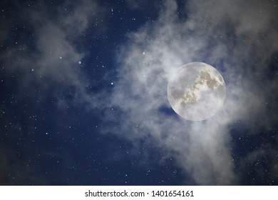 Cloudy full moon night with stars