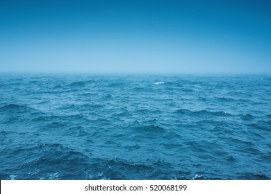 Cloudy horizon and Fog over the sea waves, natural background