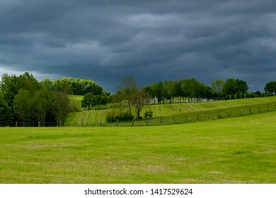 Cloudy landscape of a farm somewhere in the Eifel, Germany