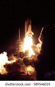 """Cloudy launch of rocket into  outer space. """"The elements of this image furnished by NASA"""""""