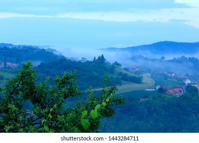 cloudy morning landscape with village in vineyards, Pozega, Slavonia, Croatia