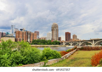 Cloudy morning in Minneapolis. Minneapolis downtown skyline and Third Avenue Bridge above Mississippi river. Midwest USA, Minnesota state.