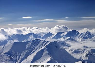 Cloudy mountains at evening. Caucasus Mountains, Georgia, view from ski resort Gudauri.