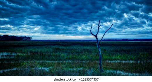 A cloudy night over the Colleton River tidal marshes in Beaufort County South Carolina, near Port Royal Sound and Hilton Head Island.
