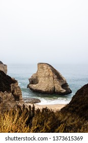 A cloudy overlook of Shark Fin Cove along the Pacific Coast Highway in Davenport, California, USA.