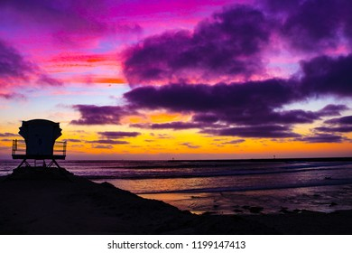 Cloudy Pink Sunset On The Beach