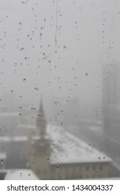 Cloudy rainy day in summer in Moscow city (Russia). Sudden cold snap, drops on window glass and cityscape
