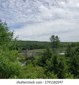 Cloudy sky above Basin Pond, western Massachusetts