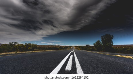 Cloudy sky above an empty road