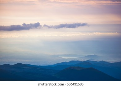 Cloudy sky above the hills