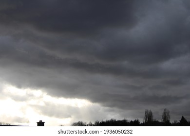 Cloudy sky.  Black gray clouds are in the sky.