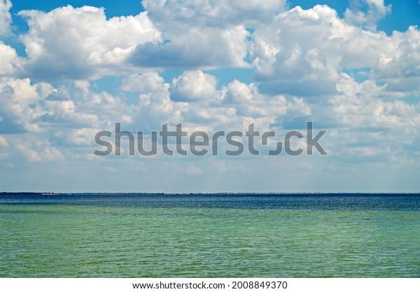 cloudy-sky-on-warm-summer-600w-200884937