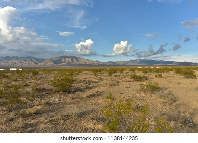 cloudy sky over Mojave desert valley and mountain ranges around Pahrump, Nevada, USA