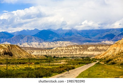 Cloudy sky over a mountain valley. Mountain valley landscape. Hill valley in mountains - Shutterstock ID 1985783390