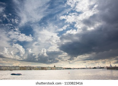 Cloudy sky over the Neva in the center of Saint Petersburg with the dome of St Isaac's Cathedral and one of the bastions of Peter and Paul Fortress. The city is famous for its quick changes in weather