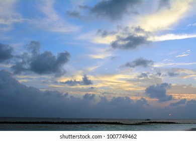 Cloudy sky over the sea at sunset