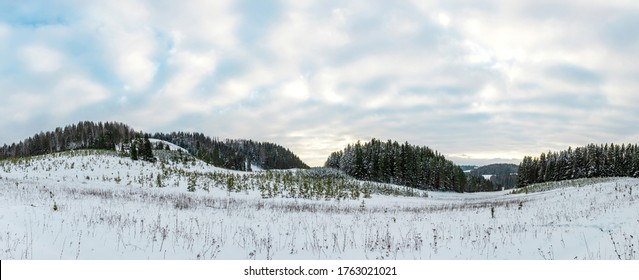 Cloudy sky over the snowy plain of central Russia