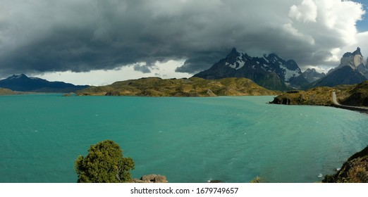 Cloudy sky over turquoise water of Pehoe Lake in Torres Del Paine, Patagonia, Andes, Chile.