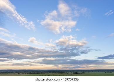 Cloudy sky over Zhizdra river valley at evening twilight. Verkhnee Alopovo village, Kaluzhskaya region, Russia.
