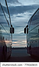 The cloudy sky is reflected in smooth tourist buses