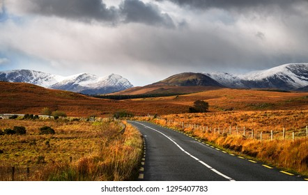 Cloudy sky and road to the mountains in Connemara, County Galway, Ireland