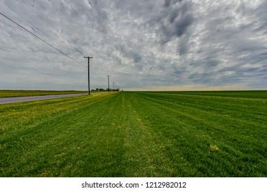 Cloudy sky and sod fields off Griers Lane in Upper Deerfield, New Jersey.