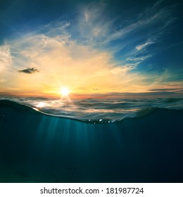 Cloudy sky with the sun split by waterline to underwater scene as design template.