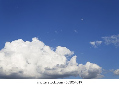 Cloudy sky visible moon. Measuring the distance