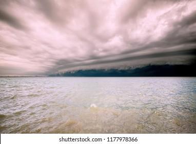 Cloudy storm in the sea before the rain. tornado storms cloud above the sea. Monsoon season. Hurricane Florence. Hurricane Katrina.