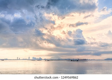 Cloudy storm view by the shore during sunrise