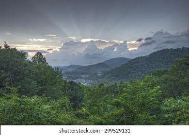 Cloudy summer morning sunrise over Gatlinburg, Tennessee.  Image taken from Gatlinburg bypass overlook.