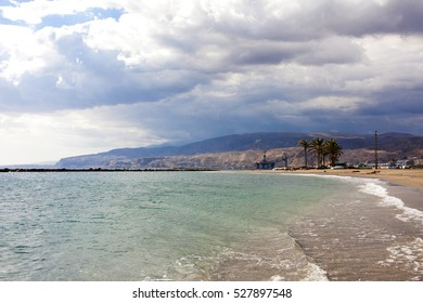 cloudy sunny day at Almeria beach with turquoise water, southern Spain, Andalusia