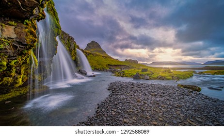 Cloudy sunrise at the most iconic waterfall in Iceland, the Kirkjufellsfoss in the The Snaefellsnes Peninsula, West Iceland.