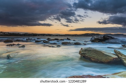 Cloudy Sunrise Seascape from Rock Platform - from The Haven at Terrigal on the Central Coast, NSW, Australia.