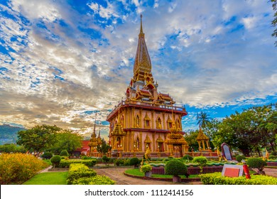 cloudy sunset above beautiful pagoda in Chalong temple Phuket Thailand