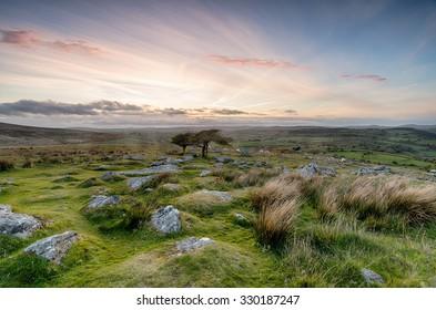 Cloudy sunset from Combestone Tor near Yelverton on Dartmoor in Devon