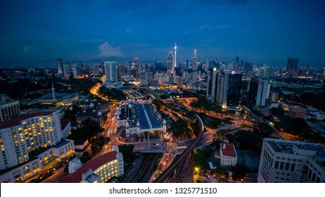 Cloudy sunset over Kuala Lumpur City Skyline showing the transportation arteries withing the heart of the city's transportation hub.