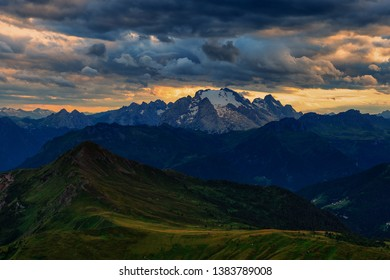 Cloudy sunset over the peaks of Marmolada, Dolomites, Italy
