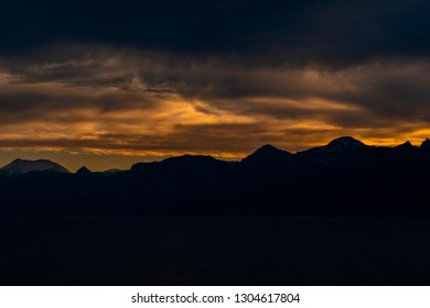 Cloudy Sunset Sky Over Mountains