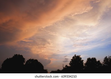 Cloudy Sunset Sky with Tree Line