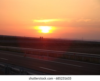 Cloudy sunset view on motorway