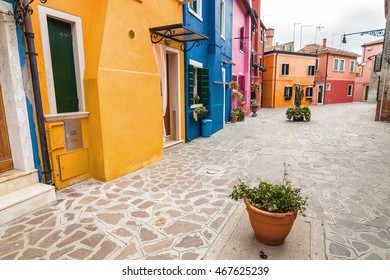 Cloudy view of little yard of Burano island, famous Venice landmark, Veneto region, Italy.
