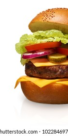 Clouse up of delicious hamburger with cheese, pickles, tomato, onions and lettuce isolated on white background. Clipping path included