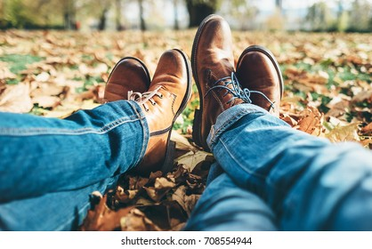 Clouse up image couple in love legs in comfortable laser shoes and denim pants