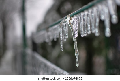clouseup of an icicle haging from a string