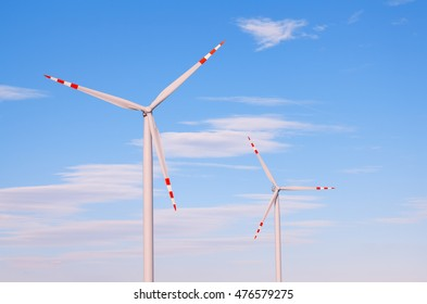 clouseup on wind turbines generating electricity