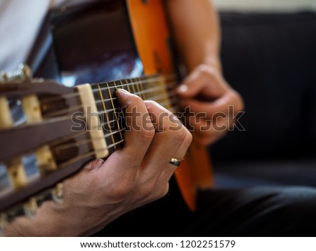 Clouseup of person playing classical guitar